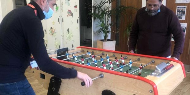 Two People Playing Table Footy